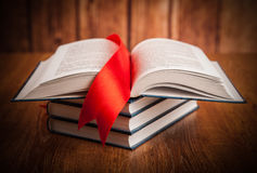 Stack of books with bookmark Royalty Free Stock Images