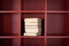 Stack of books on a bookshelf Stock Photo