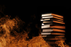 Stack of books in a burning fire Royalty Free Stock Image