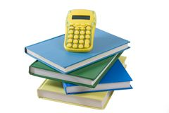 Stack of books with calculator Royalty Free Stock Photo