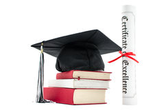 Stack of books with cap and diploma. On white background Royalty Free Stock Photography