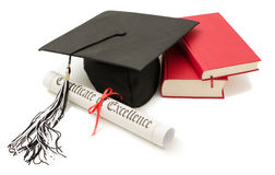 Stack of books with cap and diploma. On white background Royalty Free Stock Image