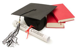 Stack of books with cap and diploma. On white background Royalty Free Stock Images