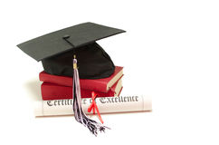 Education concept. Stack of books with cap and diploma on white background Stock Image