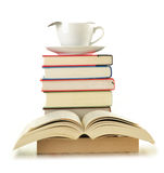 Stack of books and coffee isolated on white Royalty Free Stock Photo