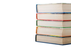 A stack of books in color covers isolated on white background. S Stock Photo