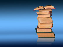 Stack of books on the color gradient background, space for text Stock Photo
