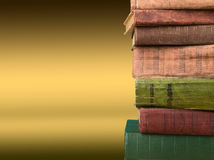 Stack of books on the color gradient background, space for text Royalty Free Stock Images