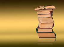 Stack of books on the color gradient background, space for text Royalty Free Stock Photo