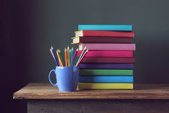 Stack of books  and colored pencils. Back to school. Stock Photography