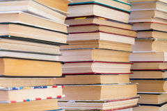 A stack of books with colorful covers. The library or bookstore. Books or textbooks. Education and reading stock photo