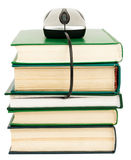 Stack of books and computer mouse Royalty Free Stock Image