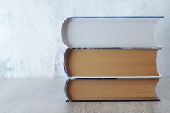 A stack of  books with copy space. Three big books symbolizing education and study royalty free stock image