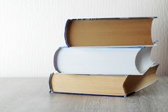 A stack of  books with copy space. Three big books symbolizing education and study royalty free stock photo