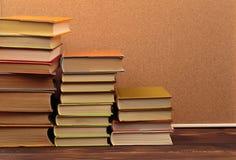 Stack of books on cork  background.Education. Image stock image