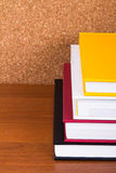 Stack of Books with Cork Board Stock Photo