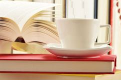 Stack of books and cup of coffee Royalty Free Stock Photo