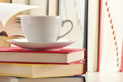 Stack of books and cup of coffee Stock Photos