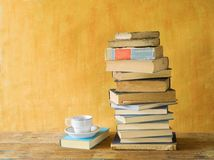 Stack of books, with a cup of coffee Royalty Free Stock Images