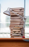 The stack of books on the desk in education concept Stock Photos