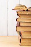 stack of books on the desk over wooden background Royalty Free Stock Images