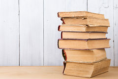 stack of books on the desk over wooden background Royalty Free Stock Photos