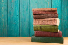 stack of books on the desk over wooden background Stock Photography
