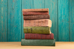 stack of books on the desk over wooden background Stock Photo
