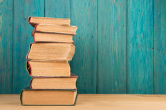stack of books on the desk over wooden background Stock Image