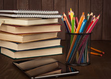 Stack of books, digital tablet and pencils Stock Image