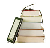 Stack of books and electronic book reader. On the white background Royalty Free Stock Images