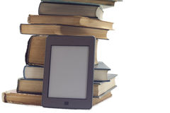 STACK OF BOOKS AND ELECTRONIC BOOK READER. Stock Photos