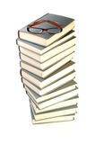 Stack of books and eyeglasses Stock Photography