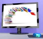 Stack Of Books Falling On Computer Shows Online Learning Stock Photo
