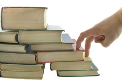 Stack of books and fingers step. Isolated on the white background Royalty Free Stock Images