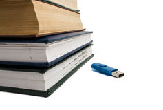 Stack of books and flash drive Stock Images
