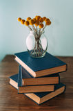 Stack of books and flowers Stock Photo