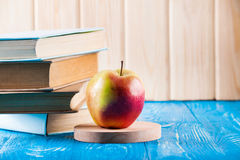 Stack of books and fresh apple Stock Image