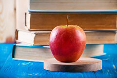 Stack of books and fresh apple Stock Photo