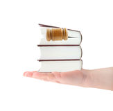 Stack of books with gavel in hand isolated Royalty Free Stock Photos