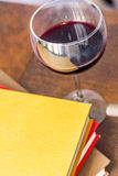 Stack of Books Glass of Wine Stock Photo