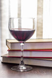 Stack of Books Glass of Wine Royalty Free Stock Image