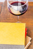 Stack of Books Glass of Wine Stock Images