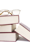 Stack of books and glasses Royalty Free Stock Images