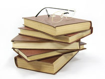 Stack of books with glasses royalty free stock image