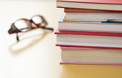 Stack of books and glasses Royalty Free Stock Photo