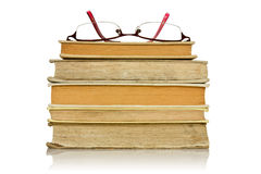 Stack of books with glasses Stock Images