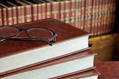 Stack of books and glasses detail. With the bottom shelf Royalty Free Stock Photos