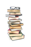 Stack of books and glasses on a white background Royalty Free Stock Photos