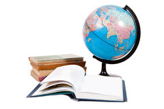 Stack of books and globe with one book open Royalty Free Stock Photo